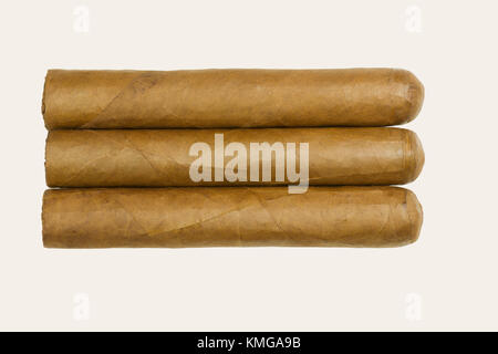 Set of three Cuban luxury cigars rolled from tobacco leaves isolated on white background - Stock Photo