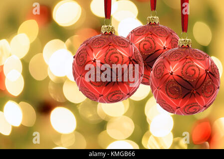 ... Beautiful Christmas Decoration   Red Baubles On A Background Of Blurred  Lights On A Christmas Tree