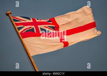 The British Royal Navy White Ensign at the stern of the historic warship HMS Victory at Portsmouth Historic Dockyard, - Stock Photo