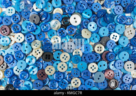 Set of blue sewing buttons on white background