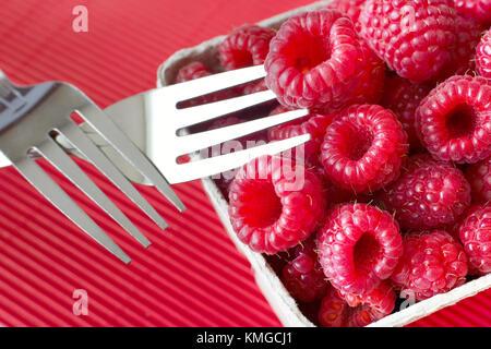 fresh red raspberries - raspberry fruit in the kitchen - Stock Photo