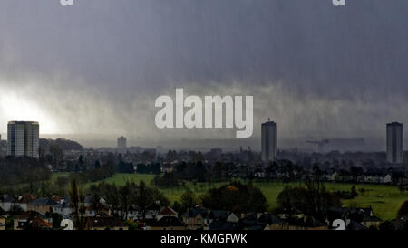 Glasgow, Scotland, UK  7th December. UK Weather: Strong wind and rain flash storm as Caroline hits Glasgow city. - Stock Photo