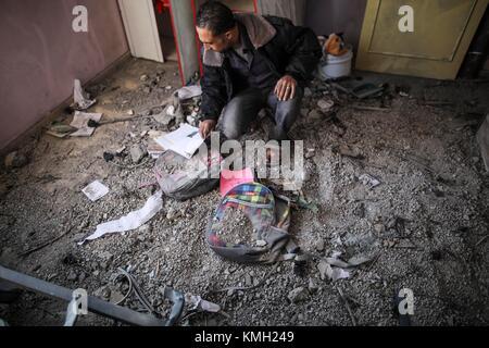 Gaza. 9th Dec, 2017. A Palestinian checks his damaged house in Beit Lahia town, northern Gaza Strip, on Dec. 9, - Stock Photo