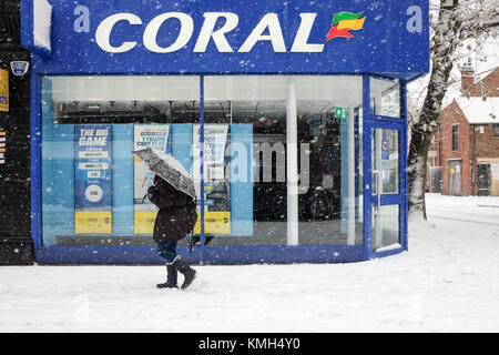 Lonodn, UK. 10th Dec, 2017. A person with an umbrella walks through the snow in Finchley, North London, on 10 December - Stock Photo