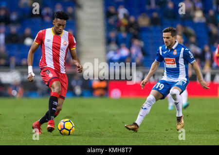 SPAIN - 11th of December: Girona FC SAD defender Johan Mojica (3) and RCD Espanyol midfielder Pablo Piatti (19) - Stock Photo