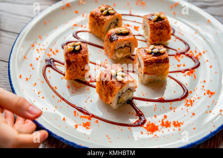 Traditional japanese sushi rolls in restaurant - Stock Photo