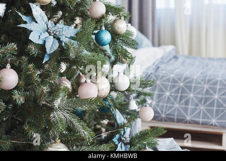 Close up of colorful ornaments on Christmas tree. - Stock Photo