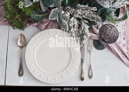 Table served for Christmas dinner in living room, top view. - Stock Photo