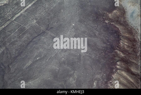 Aerial photograph of the hummingbird, one of the Nazca lines, large ancient geoglyphs in the Nazca Desert, in southern - Stock Photo