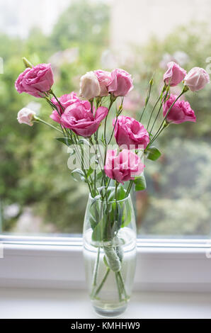 beautiful bouquet of bright pink flowers eustoma - Stock Photo
