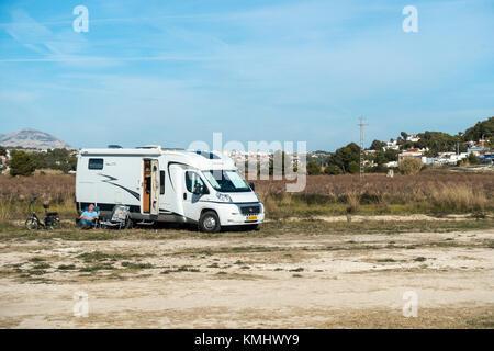 Wild camping in campervan rv on spare ground in Moraira, Costa Blanca, Spain. - Stock Photo