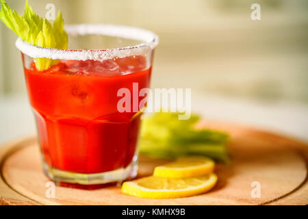Bloody Mary alcoholic drink with lemon and celery - Stock Photo