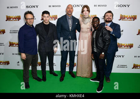 (Left to right) Jake Kasdan, Nick Jonas, Dwayne Johnson, Karen Gillan, Kevin Hart and Jack Black attending the Jumanji: Welcome to the Jungle Premiere held at The Vue West End in Leicester Square, London.