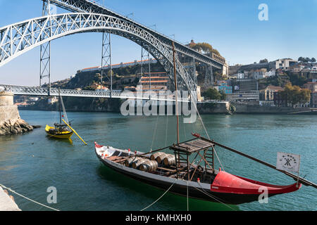 traditional Rabelo boats for Port wine on the River Douro waterfront in the Ribeira district of Porto, Portugal. - Stock Photo