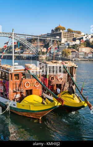 traditional Rabelo boats for Port wine now used for cruises. On the River Douro waterfront in the Ribeira district - Stock Photo