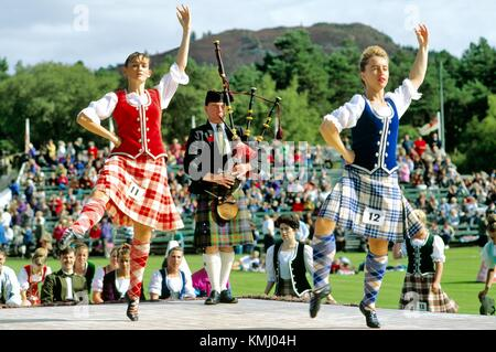 Girls at highland dancing competition contest at the annual Braemar Gathering near Balmoral in Grampian region of - Stock Photo