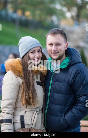 Young Couple Walking Through Autumn Park - Stock Photo
