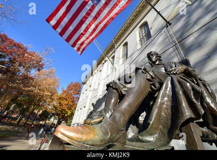 Harvard Statue in the fall - Stock Photo
