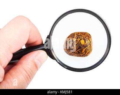 view of scriptstone (Mariam jasper) gemstone through magnifier isolated on white background - Stock Photo