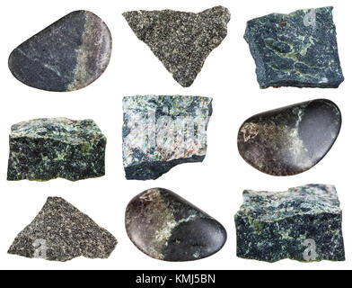 collection of natural mineral specimens - various Dunite (Olivinite) stones isolated on white background - Stock Photo