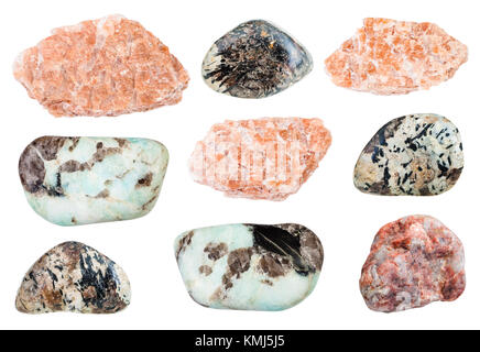 collection of natural mineral specimens - various Pegmatite rocks isolated on white background - Stock Photo