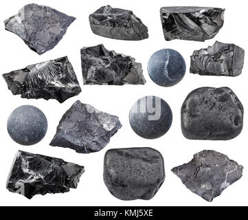 collection of natural mineral specimens - various Shungite stones isolated on white background - Stock Photo