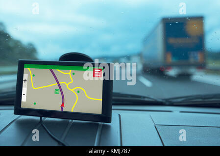 GPS (Global Positioning System) car navigation device, help and assistance with direction on road - Stock Photo