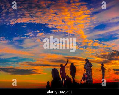Silhouettes at sunset. Morocco - Stock Photo