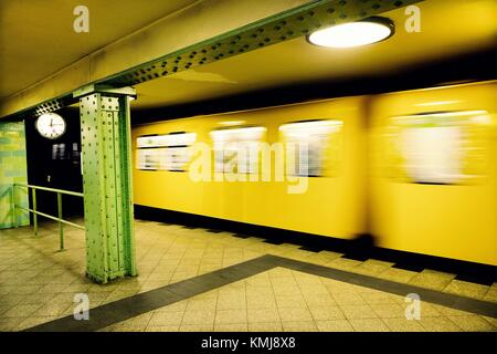 Moving train in Voltastrasse subway station. Berlin, Germany - Stock Photo