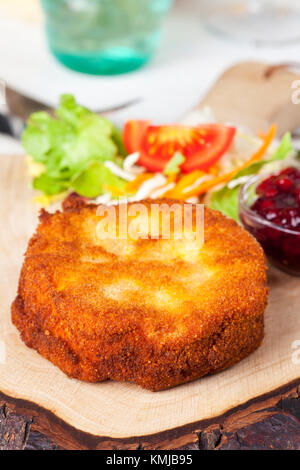 breaded camembert with salad on wood - Stock Photo