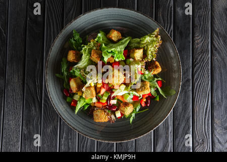 Salad with beans, falafel and vegetables - Stock Photo