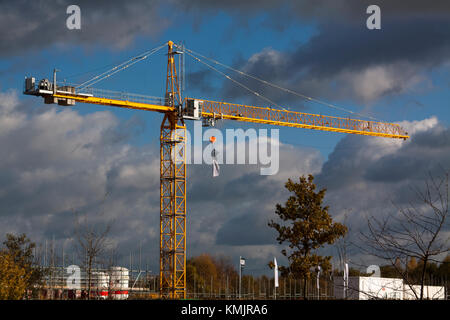 Crane working on building site - Stock Photo