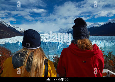 Tourists on walkway and Perito Moreno Glacier, Parque Nacional Los Glaciares (World Heritage Area), Patagonia, Argentina, - Stock Photo