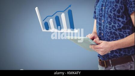 Digital composite of Hand holding tablet with 3D bar chart statistics icon - Stock Photo