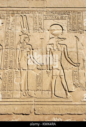 Reliefs of Sobek with crocodile head and Isis surrounded by hieroglyphs in the Crocodile temple in Kom Ombo: the - Stock Photo