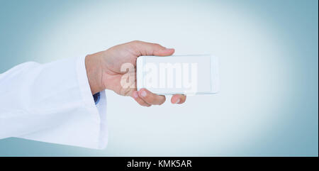 Cropped image of male doctor holding smart phone with blank screen against white background - Stock Photo