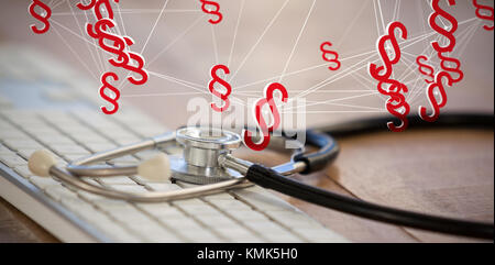 Vector icon of section symbol against close-up of keyboard with stethoscope - Stock Photo