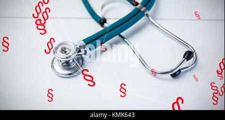 Vector icon of section symbol against stethoscope on desk - Stock Photo