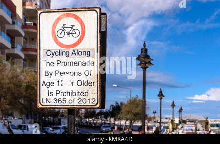 Sign in Sliema, Malta, warning cyclists over the age of 12 not to cycle on the Promenade - Stock Photo