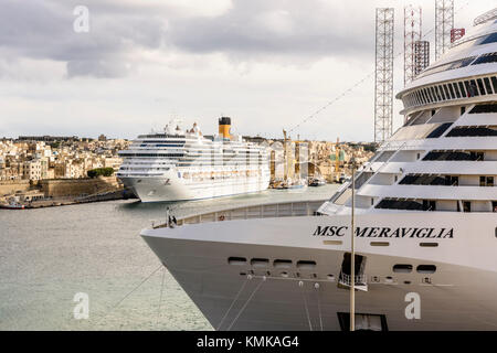 Cruise liner ships MSC Meraviglia and Costa Fascinosa in Valletta Harbour, Malta - Stock Photo
