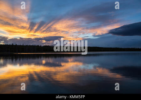 The sunset reflects off of the Flat Mountain Arm of Yellowstone Lake at the Yellowstone National Park August 6, - Stock Photo