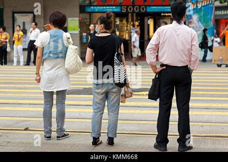 Pedestrians with face mask, Hong Kong island, SAR, China - Stock Photo