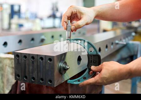 Quality control technician, Checking the measurement with micrometer, Mechanical industry, Gipuzkoa, Basque Country, - Stock Photo