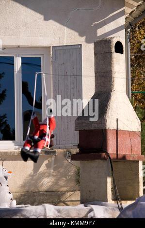 Barbeque and Santa in garden, Cazals, France - Stock Photo