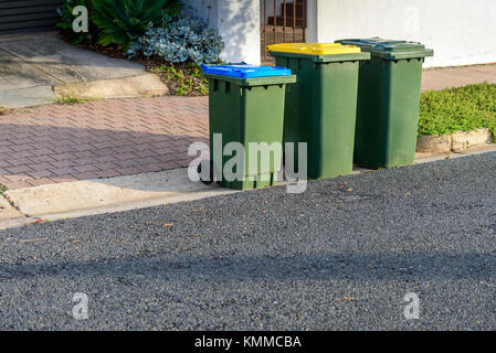 Kerbside waste bins ready for collection by local council in Australian suburb - Stock Photo