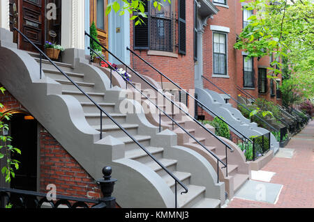 South End, Boston Victorian row houses. Brick aparment buildings and sidewalks, colorful steps with wavy stone trim, - Stock Photo