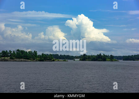 Thousand Islands National Park on St. Lawrence River; USA, Canada - Stock Photo