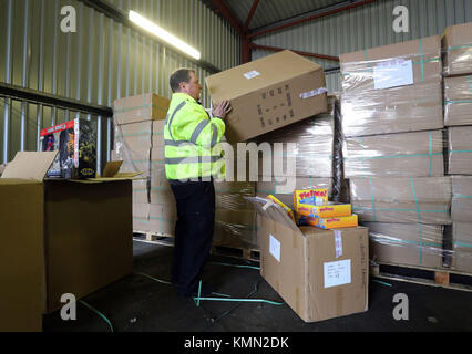 EDITORS NOTE: Consignment labels pixelated by PA picture desk Border Force officer Robert Martin with goods seized - Stock Photo