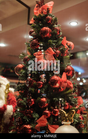 Image of decorated Christmas tree with red balls and bows - Stock Photo