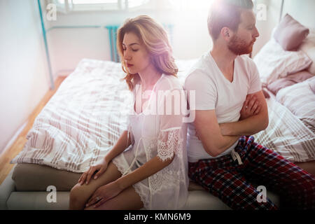 Stressed couple arguing and having marriage problems - Stock Photo